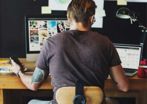 Man telecommuting from his home office